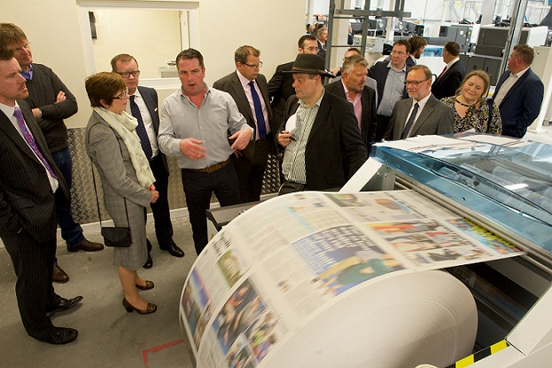 KP Services (Jersey) Limited. Launch of new printing press at Rue des Pres, St Saviour, Jersey. Alan Palin (grey shirt), General Manager of KP Services explains the Hunkeler Finishing Line printing the Daily Mail newspaper 13-5-16 Photo by Rob Currie NO UNAUTHORISED REPRODUCTION OR COPYING