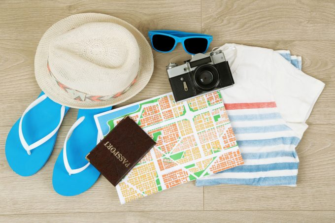 51719738 - summer vacation clothes, shoes and hat on wooden background